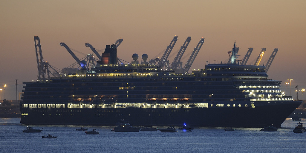 . LONG BEACH, CALIF. USA -- The youngest Cunard Line ship, Queen Elizabeth, arrives in the Long Beach (Calif.) Harbor after visiting the Queen Mary on March 12, 2013. The Queen Mary was built by Cunard in 1936 and retired in 1967. The Queen Mary, now a permanently berthed, is a hotel and special events venue. The two ships exchanged whistle blows.   Photo by Jeff Gritchen / Los Angeles Newspaper Group