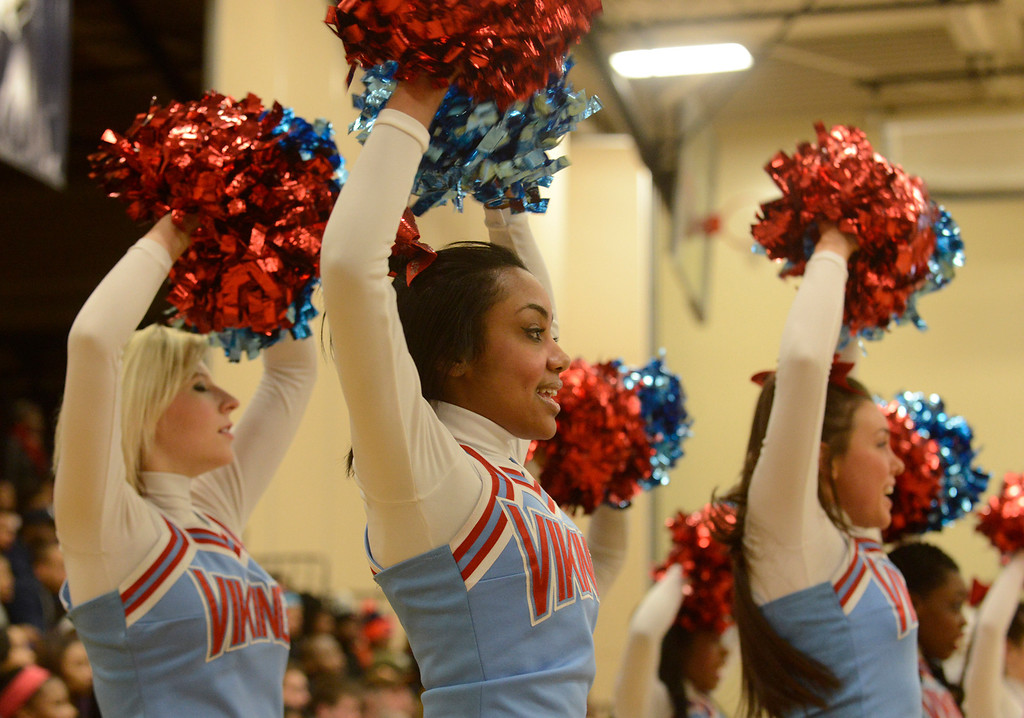 . Maribeth Joeright/MJoeright@News-Herald.com<p>  Villa Angela-St. Joseph cheerleaders rally their team and their classmates during the district chamionship game against Warrensville Heights, March 7, 2014.