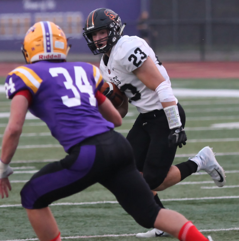 . Randy Meyers - The Morning Journal<br> Darren Anders of North Olmsted tries to run past Avon\'s Peyton Butrey during the first quarter on Sept. 14.