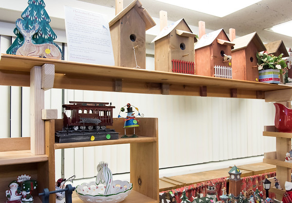 11/30/18 Wesley Bunnell | Staff The Berlin Historical Society is holding their annual craft fair Friday 11/30 and Saturday 12/1 at their museum at 305 Main St with the theme of a child's Christmas in Berlin. One section of handmade birdhouses sit atop Christmas decorations.