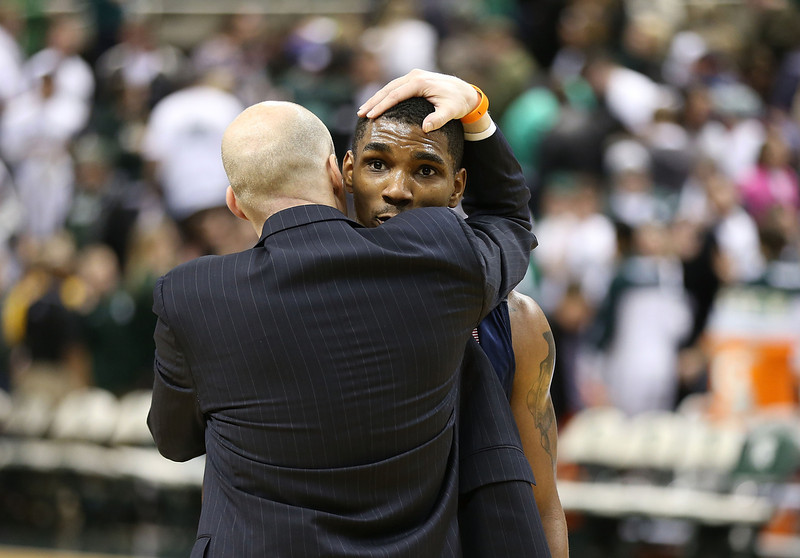 . University of Illinois head basketball coach John Groce hugs Tracy Abrams #13 after the win over Michigan State Spartans at Breslin Center on March 1, 2014 in East Lansing, Michigan. Illinois defeated Michigan State 53-46.  (Photo by Leon Halip/Getty Images)