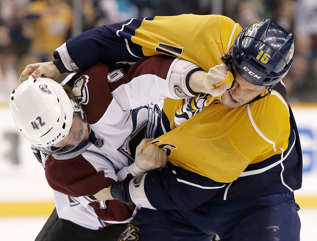 . Colorado Avalanche center Brad Malone (42) fights with Nashville Predators left wing Rich Clune (16) in the first period of an NHL hockey game Tuesday, April 2, 2013, in Nashville, Tenn. (AP Photo/Mark Humphrey)