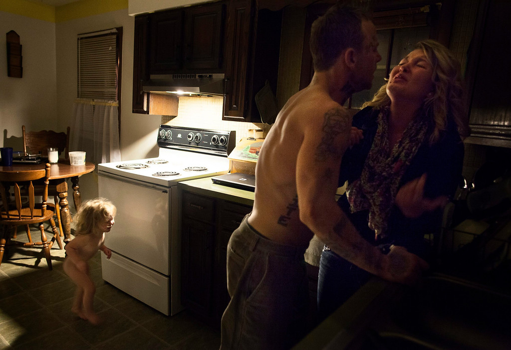 . This picture by US photographer Sara Naomi Lewkowicz won 1st Prize in Contemporary Issues Stories category of the 57th World Press Photo Contest, it was announced by the organizers in Amsterdam, The Netherlands, 14 February 2014. It shows Shane and Maggie fighting as Memphis (L) ran into the room, a portrait of domestic violence, in Lancaster, USA.  EPA/SARA LEWKOWICZ / TIME