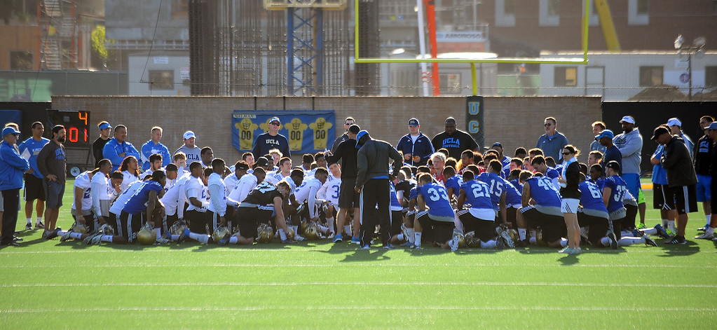 . UCLA head coach Jim Mora tlaks to his team on the final day of spring practice Thursday, April 24, 2014.(Andy Holzman/Los Angeles Daily News)