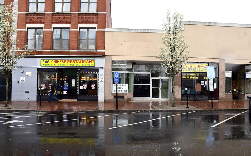 4/9/2020 Mike Orazzi | Staff  Cheng's Kitchen and New China are temporarily closed because of COVID-19 in downtown New Britain on Thursday.