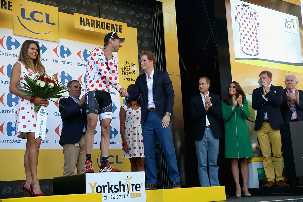 . Leader in the king of the mountains classification, Jens Voigt of Germany shakes hands with Prince Harry at the finish line of Stage 1 of the Tour De France  in Harrogate, northern England on July 5, 2014. British sprint ace Mark Cavendish was taken to hospital after crashing during the opening stage of the Tour de France. Cavendish, 29, crashed hard in the finishing sprint in Harrogate, where his mother was born, at the end of the 190km opening stage from Leeds. He was seen holding his collarbone on the tarmac, visibly in pain, before cradling his arm in his lap and grimacing as he rode to the finish line one-handed. Chris Jackson/AFP/Getty Images