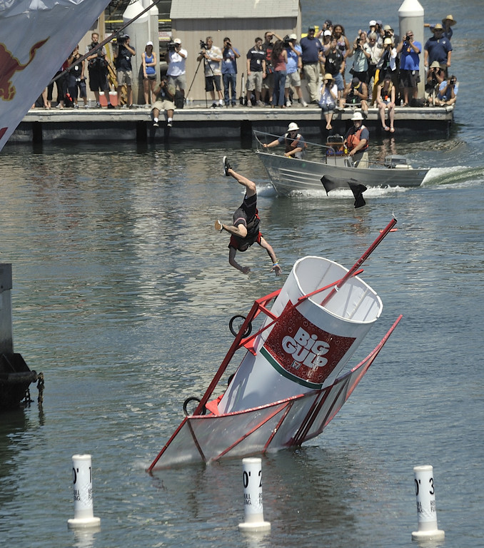 """. LONG BEACH, CALIF. USA -- Chris Nunnally pilots \""""Team Big Gulp\"""" during the Flugtag in Rainbow Harbor in Long Beach, Calif. on August 21, 2010. Thirty five teams competed in the Red Bull event where teams build homemade, human-powered flying machines and pilot them off a 30-foot high deck in hopes of achieving flight.  Flugtag means \""""flying day\"""" in German. They are on distance, creativity and showmanship..Photo by Jeff Gritchen / Long Beach Press-Telegram.."""