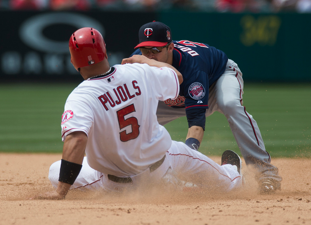 . Angels\' Albert Pujols (#5) is tagged out trying to steal second base by Minnesota Twins second baseman Brian Dozier (#2) Angel Stadium in Anaheim on Thursday June 26, 2014. The Angels beat the Minnesota Twins 6-4. (Photo by Keith Durflinger/Whittier Daily News)