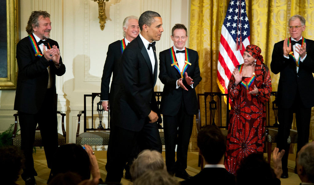 . President Barack Obama is applauded by the 2012 Kennedy Center Honors recipients, from left, rock band Led Zeppelin singer Robert Plant, guitarist Jimmy Page, and keyboardist/bassist John Paul Jones, ballerina Natalia Makarova and comedian and television host David Letterman, at the conclusion of a reception hosted by President Barack Obama and first lady Michelle Obama for the honorees in the East Room of the White House in Washington, Sunday, Dec. 2, 2012.  While Led Zeppelin is being honored as a band, surviving members John Paul Jones, Jimmy Page, and Robert Plant, each received the Kennedy Center Honors. (AP Photo/Manuel Balce Ceneta)