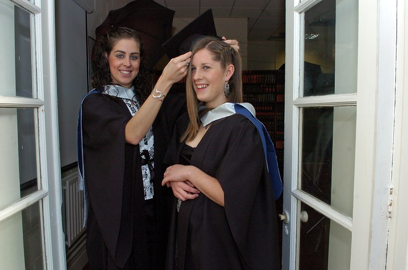 Provision 261006 Deirdre O'Callaghan (Dublin) and Allison Miller (Carlow) getting ready before their graduation ceremony in WIT yesterday (Weds).  Both graduated with a Bachelor of Business in Recreation and Leisure. PIC Bernie Keating/Provision
