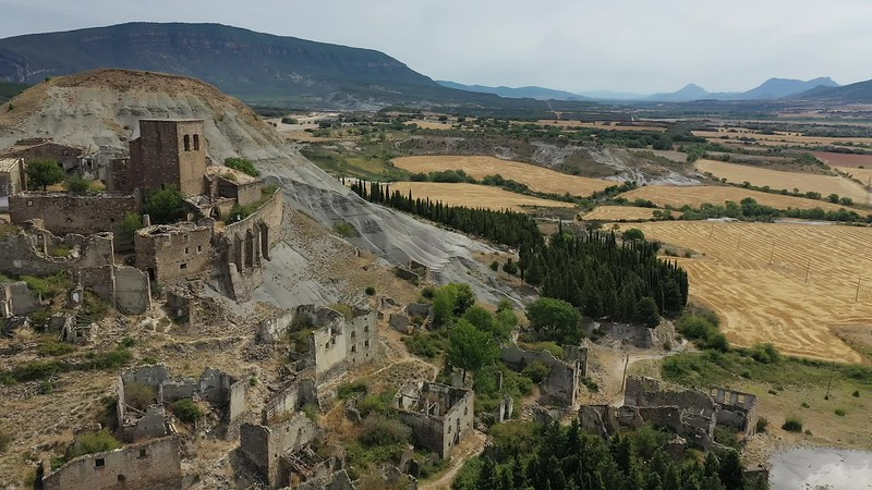 Available in 4k - Aerial drone clip showing abandoned village of Esco at the Embalse de Yesa (Yesa Reservoir) in the Navarra Aragon region of the Spanish Pyrenees