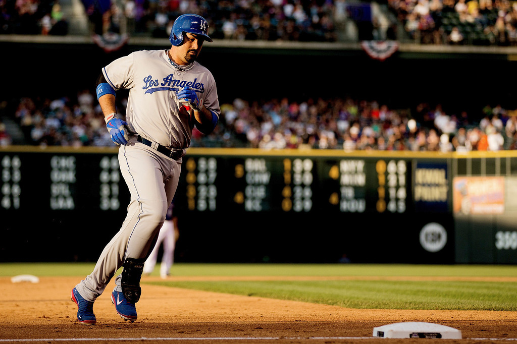 . Adrian Gonzalez #23 of the Los Angeles Dodgers rounds the bases after hitting a two-run home run during the third inning against the Colorado Rockies at Coors Field on July 2, 2013 in Denver, Colorado.  (Photo by Justin Edmonds/Getty Images)