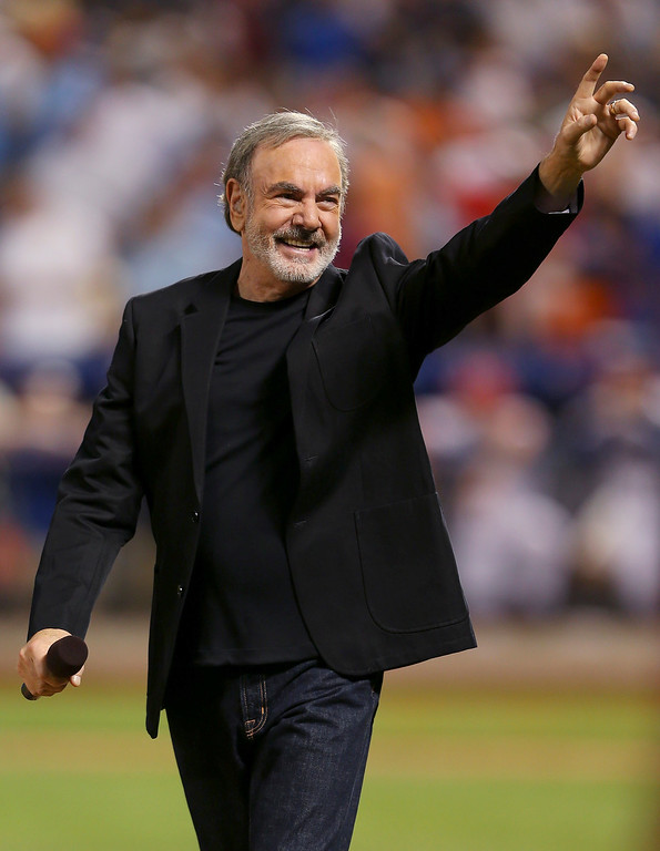 . NEW YORK, NY - JULY 16:  Singer Neil Diamond performs during the 84th MLB All-Star Game on July 16, 2013 at Citi Field in the Flushing neighborhood of the Queens borough of New York City.  (Photo by Mike Ehrmann/Getty Images)