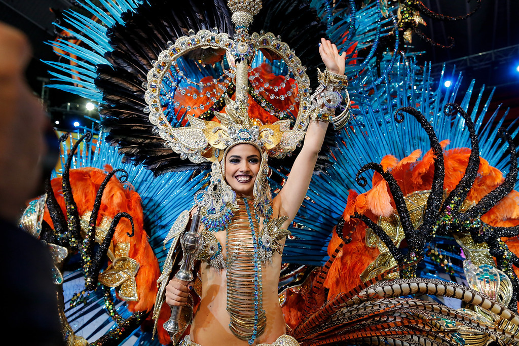 . Amanda Perdomo celebrates after being elected Queen of the 2013 Santa Cruz carnival on February 26, 2014 in Santa Cruz de Tenerife on the Canary island of Tenerife, Spain. The Carnival of Santa Cruz de Tenerife brings every year thousands of revellers. Santa Cruz is the closest European equivalent to the Brazilian Carnival from Rio Janeiro.  (Photo by Pablo Blazquez Dominguez/Getty Images)