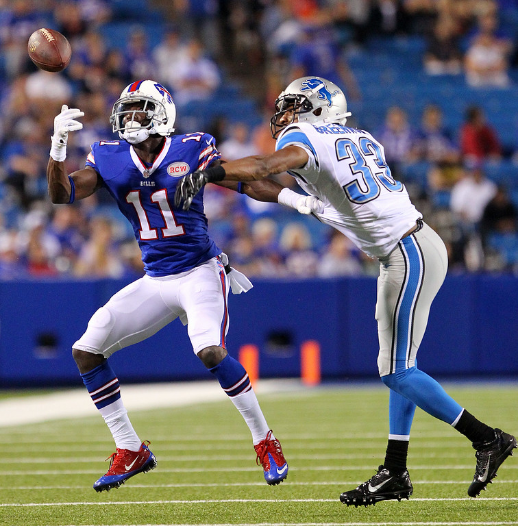 . Detroit Lions cornerback Chris Greenwood (33) breaks up a pass intended for Buffalo Bills wide receiver T.J. Graham (11) during the second half of a preseason NFL football game, Thursday, Aug. 28, 2014, in Orchard Park, N.Y. (AP Photo/Bill Wippert)