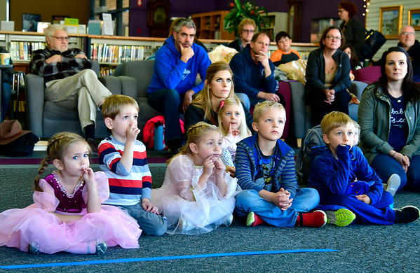 11/10/2018 Mike Orazzi   Staff Children and parents listen to a presentation by Christine's Critters during a Renaissance Faire held at the Southington Public Library Saturday.