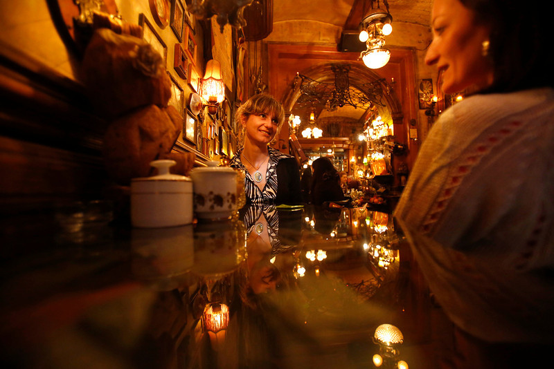". In this May 7, 2014 photo, Bosnian woman enjoy a coffee in a bar in Sarajevo, Bosnia-Herzegovina. Despite the dark chapters of the past, today the city is defined by what locals call ""the Sarajevo Spirit\"", an interesting and mostly harmonious mix of religions and cultures. (AP Photo/Amel Emric)"
