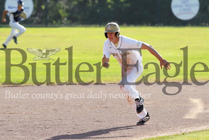 Kyle Weitzel breaks toward third base against Freeport Tuesday evening. Seb Foltz/Butler Eagle