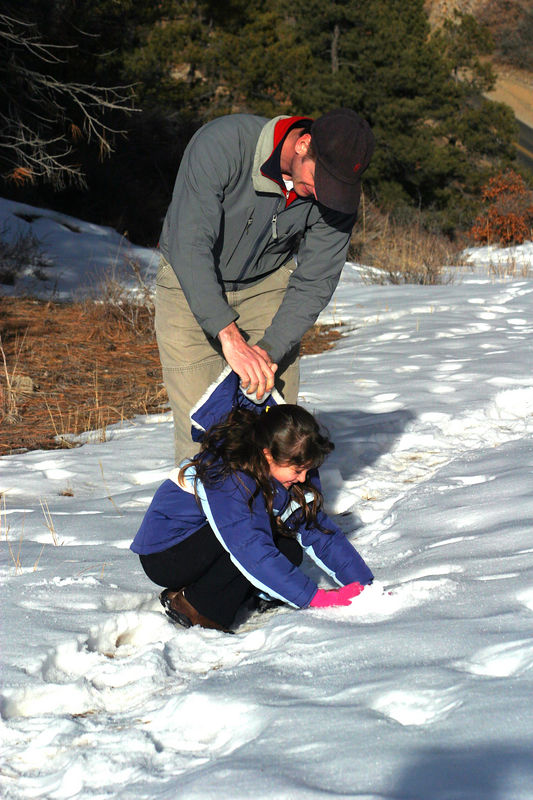 Rich putting a snowball into Anisa's hood when she wasn't looking.