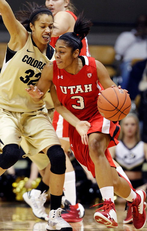 . Utah\'s Iwalani Rodrigues (3) looks for an opening to pass against Colorado\'s Arielle Roberson during the first half of their NCAA college basketball game, Tuesday, Jan. 8, 2013, in Boulder, Colo. (AP Photo/Brennan Linsley)
