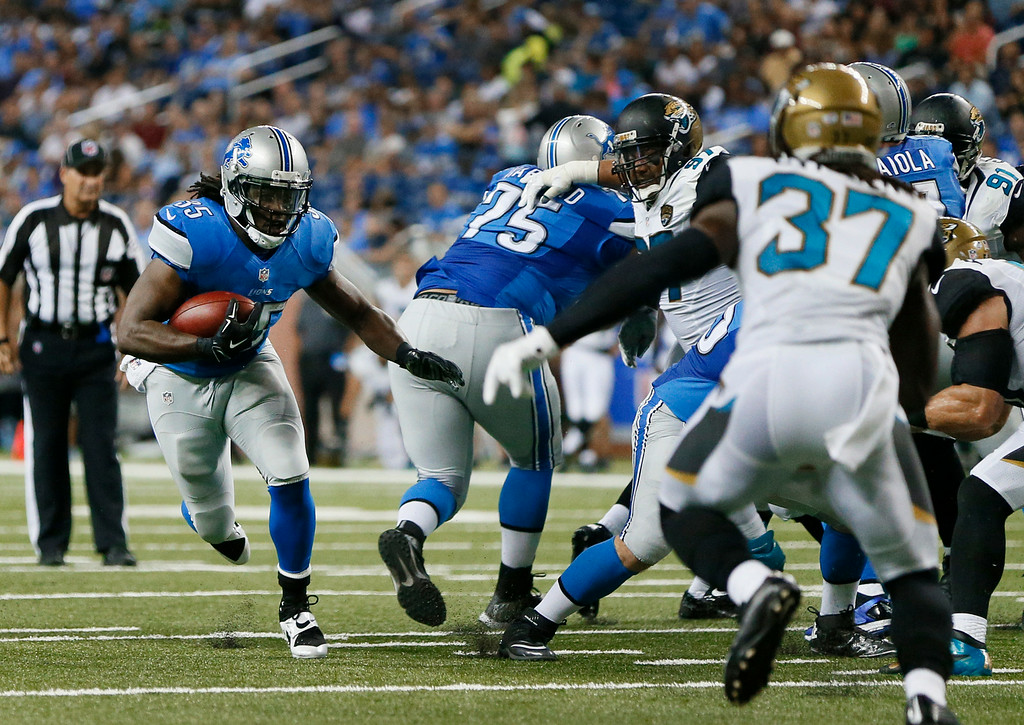 . Detroit Lions running back Joique Bell (35) runs against the Jacksonville Jaguars in the first half of a preseason NFL football game at Ford Field in Detroit, Friday, Aug. 22, 2014. (AP Photo/Rick Osentoski)