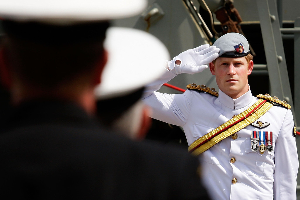 . Prince Harry salutes members of the Royal Australian Navy prior to boarding the Leeuwin on October 5, 2013 in Sydney, Australia. Over 50 ships participate in the International Fleet Review at Sydney Harbour to commemorate the 100 year anniversary of the Royal Australian Navy\'s fleet arriving into Sydney. Prince Harry is an official guest of the Australian Government and will take part in the fleet review during his two-day visit to Australia.  (Photo by Lisa Maree Williams/Getty Images)