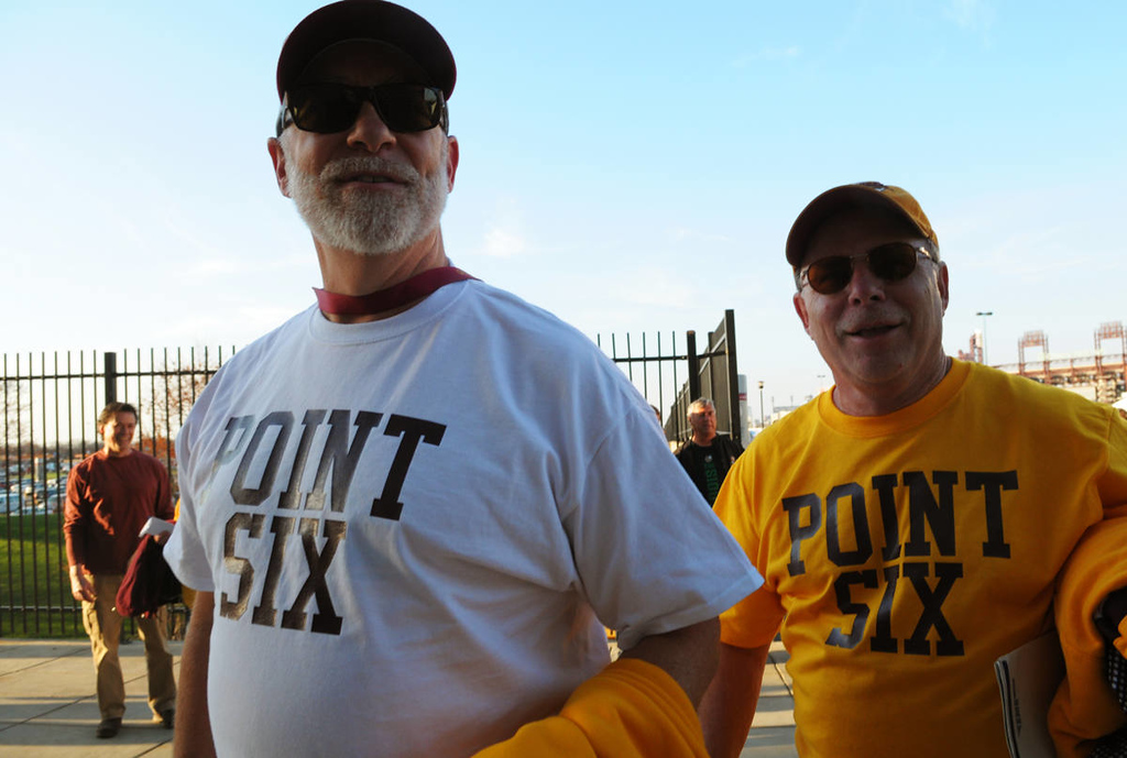 . Lee Beauduy, right, from Blaine, and Joe Brenny, from Corcoran, sport tee-shirts that they had made the day of the National Championship game commemorating the Gophers the game winning goal against North Dakota in the semifinal game of the NCAA Frozen Four Championship Game at the Wells Fargo Center in Philadelphia, Saturday, April 12, 2014.  (Pioneer Press: John Autey)