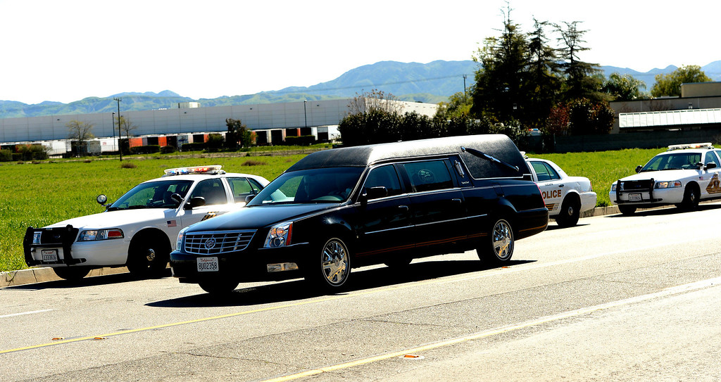 . A hearse carrying the body of San Bernardino County Sheriff\'s  Deputy Jeremiah MacKay leaves the SBCO Coroner\'s Office in San Bernardino February 14, 2013.  The Department held a small service with Color Guard, and bag pipes prior to a motorcycle led procession to Mountain View Mortuary in San Bernardino.  McKay was fugitive Christopher Dorner\'s final victim.  GABRIEL LUIS ACOSTA/STAFF PHOTOGRAPHER.