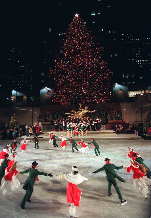 . Skaters from Walt Disney World perform a number on the ice rink  during  the 63rd annual lighting of the 75-foot high,  63-year-old, Norway Spruce in New York\'s Rockefeller Center Tuesday, Dec. 5, 1995. A contingent of  nuns from the Sisters of Christian Charity in Mendham, N.J. - the former owners of the tree - were on hand for the ceremony. (AP Photo/Ed Bailey)