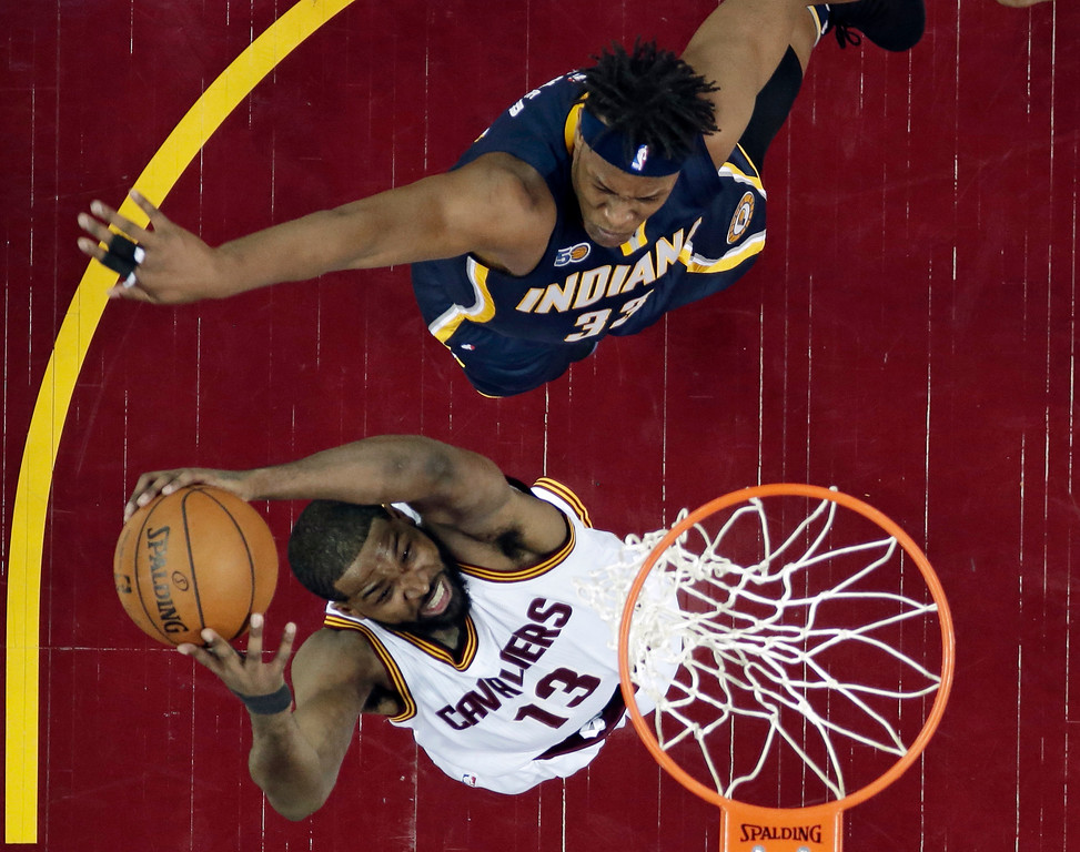 . Cleveland Cavaliers\' Tristan Thompson drives to the basket against Indiana Pacers\' Myles Turner in the first half in Game 1 of the first round of the NBA playoffs April 15 in Cleveland. The Cavaliers won 109-108, to lead the series, 1-0. Thompson led the Cavs in rebounds (13), and LeBron James led in points (32) and assists (13). (AP Photo/Tony Dejak)