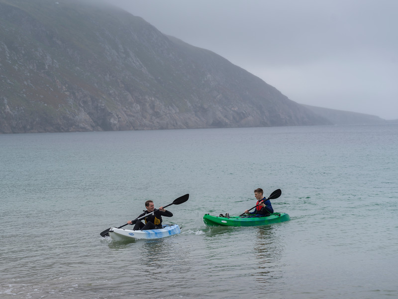 Tourists kayaking in Keem Bay, Achill Island, County Mayo, Republic of Ireland