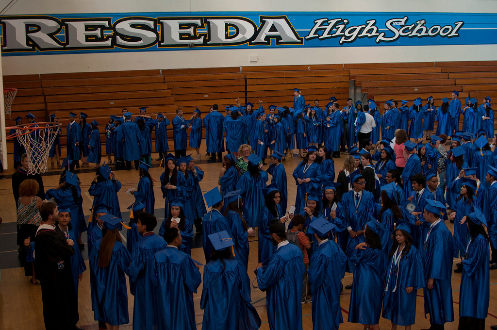 . Seniors line up in the school\'s gym before the graduation ceremony begins.The Reseda High School graduation class held their commencement in the school football field on Friday,  June 07, 2013 in Reseda, CA.   Photo by Carlos Carpio