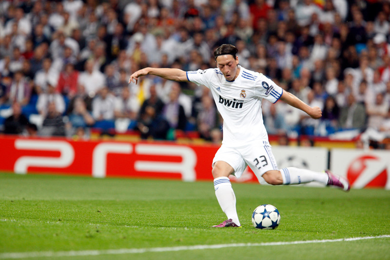 Ozil about to kick the ball, UEFA Champions League Semifinals game between Real Madrid and FC Barcelona, Bernabeu Stadiumn, Madrid, Spain