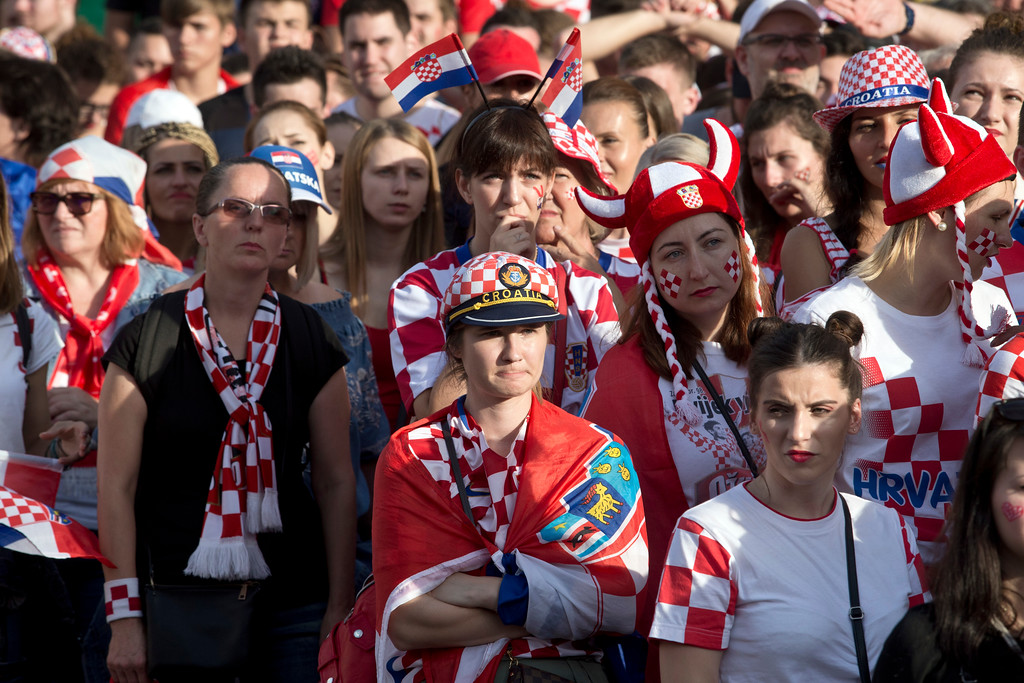 . Supporters of the Croatian national soccer team look dejected watching the match in central Zagreb, Croatia, Sunday, July 15, 2018. Croatia\'s national soccer team lost to France in the World Cup final in Russia. (AP Photo/Marko Drobnjakovic)