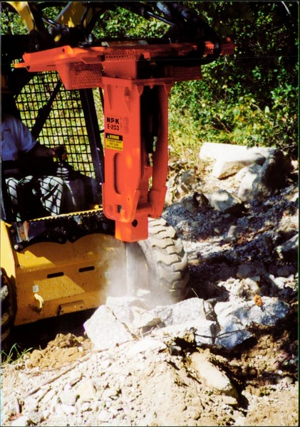 NPK E203 hydraulic hammer on Cat skid steer at NPKCE (2).JPG