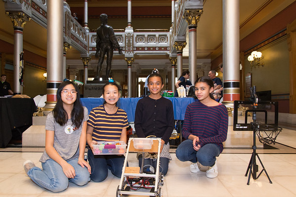 04/24/19 Wesley Bunnell | Staff A Student-Manufacturer Connection Fair was held on Wednesday at the State Capitol Building connecting over 500 students and dozens of Connecticut companies to explore careers in advanced manufacturing. The Greater Glastonbury Armored Artemises pose with their robot built to shoot baskets. Hanna Ton That, L, Sienna Standard, Clarissa Standard and Audra Becher.