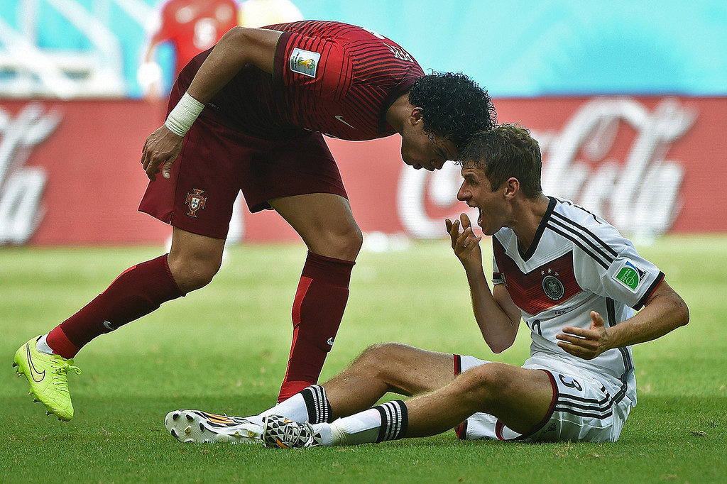 . Portugal\'s defender Pepe (R) fouls Germany\'s forward Thomas Mueller before being sent off during the Group G football match between Germany and Portugal at the Fonte Nova Arena in Salvador during the 2014 FIFA World Cup on June 16, 2014. PATRIK STOLLARZ/AFP/Getty Images