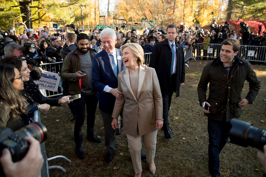 . Democratic presidential candidate Hillary Clinton, center, accompanied by her husband, former President Bill Clinton, center left, greets supporters outside Douglas G. Grafflin School in Chappaqua, N.Y., Tuesday, Nov. 8, 2016, after voting. (AP Photo/Andrew Harnik)