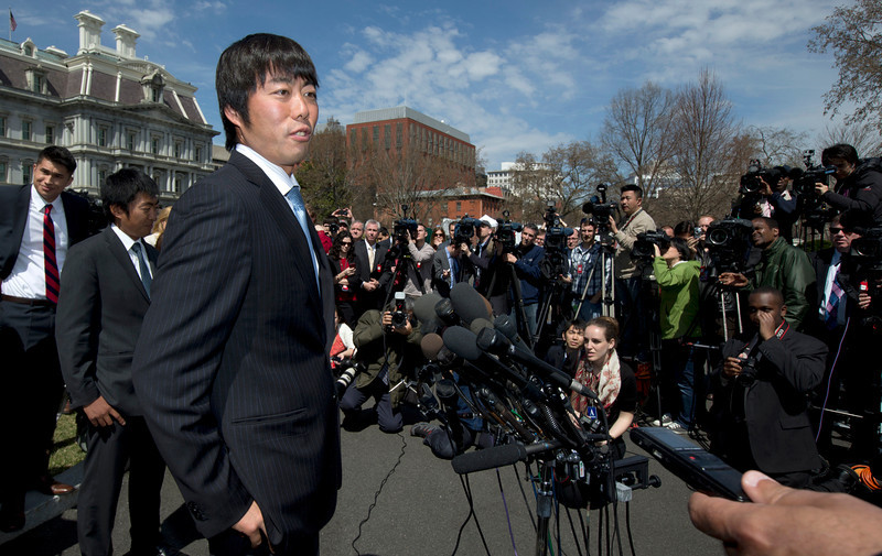 . Boston Red Sox pitcher Koji Uehara of Japan, speaks to reporters outside the White House, in Washington, Tuesday, April 1, 2014, following a ceremony where President Barack Obama honored the 2013 World Series baseball champion Boston Red Sox.  (AP Photo/Manuel Balce Ceneta)