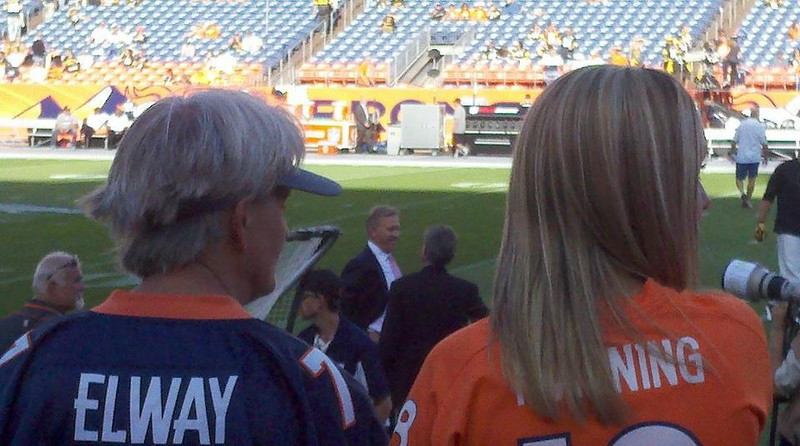 . This pic captures the eras of Bronco women in our household.  My mom is a 100% diehard fan and raised me right!! We also were able to get Mr. Elway himself in our pic. (Photo by Meg Vellone)
