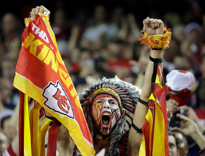 . A Kansas City Chiefs fan yells in the stands during the second quarter of an NFL football game between the Kansas City Chiefs and the New England Patriots, Monday, Sept. 29, 2014, in Kansas City, Mo. (AP Photo/Charlie Riedel)