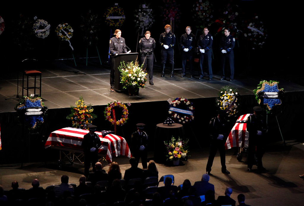 ". Wendy Bynes of the Santa Cruz police department speaks about her colleague, Detective Elizabeth Butler, the Santa Cruz police officer killed in an ambush last week, during memorial services at the HP Pavilion on Thursday, March 7, 2013, in San Jose, Calif. The service also memorialized Butler\'s partner, Sgt. Loran ""Butch\"" Baker, also killed in last week\'s ambush.  (Karl Mondon/Bay Area News Group)"