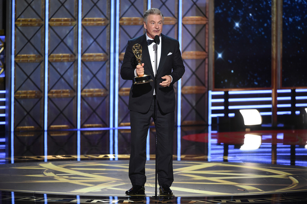 ". Alec Baldwin accepts the award for outstanding supporting actor in a comedy series for ""Saturday Night Live\"" at the 69th Primetime Emmy Awards on Sunday, Sept. 17, 2017, at the Microsoft Theater in Los Angeles. (Photo by Phil McCarten/Invision for the Television Academy/AP Images)"