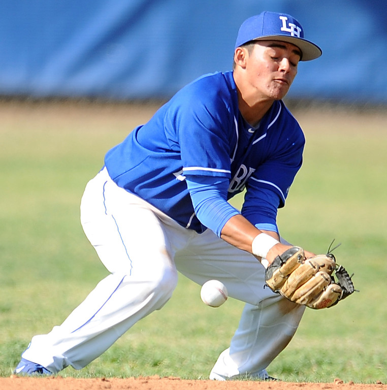 . La Habra second baseman Marcus Lopez stays in front of the hard shot and makes the play on Bonita\'s Jacob Blunt (not pictured) in the fifth inning of a prep baseball game at La Habra High School on Tuesday, April 2, 2013 in La Habra, Calif. Bonita won 8-2.  (Keith Birmingham Pasadena Star-News)