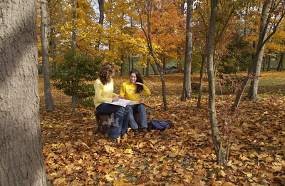23318 Students studying fall scenes Shawne Petry and Lauren Milton