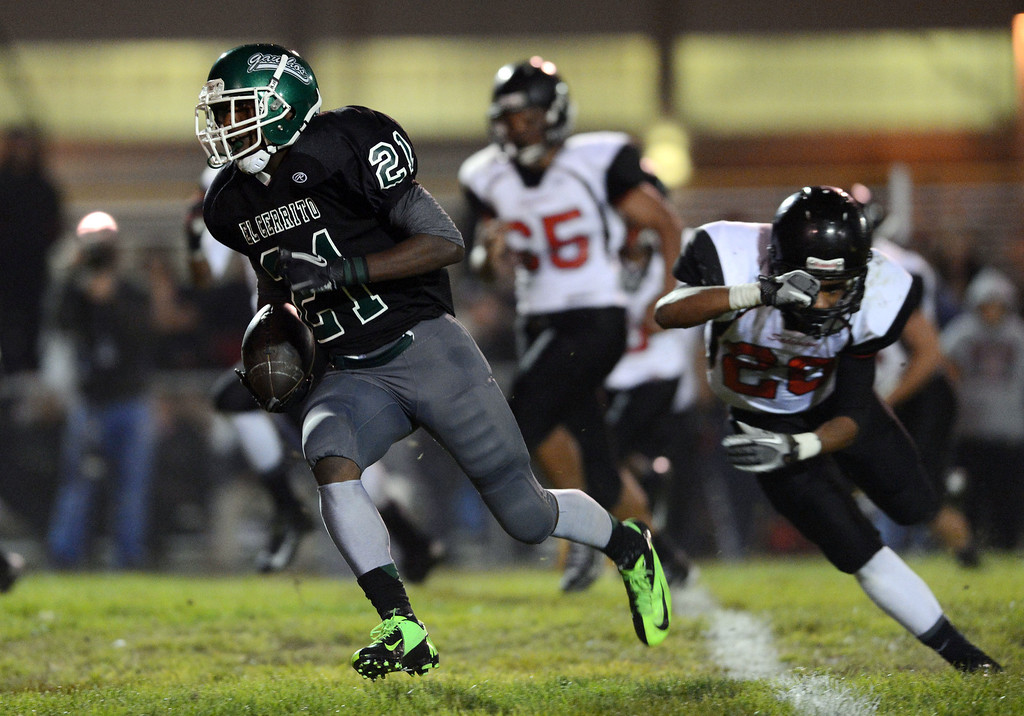 . <p>9. MARCELLUS PIPPINS � DEFENSIVE BACK � EL CERRITO</p> Pippins (21) breaks away for a 56 yard catch and run for a touchdown against Salesian High in their Tri-County Athletic League Rock Division high school football game at El Cerrito High School in El Cerrito, Calif. on Friday, September 28, 2012. (Dan Honda/Staff)