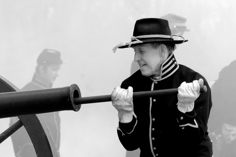 A Union artillery reenactor sponges the piece, which involves running a long sponge the length of the canon to snuff out any burning cinders. The Skirmish at Gamble's Hotel happened on March 5, 1885 when 500 federal soldiers, under the command of Reuben Williams of the 12th Indiana Infantry, marched into Florence to destroy the railroad depot but were met by Confederate soldiers backed up with 400 militia. The reenactment, held by the 23rd South Carolina Infantry, was held at the Rankin Plantation in Florence, South Carolina on Saturday, March 5, 2011. Photo Copyright 2011 Jason Barnette