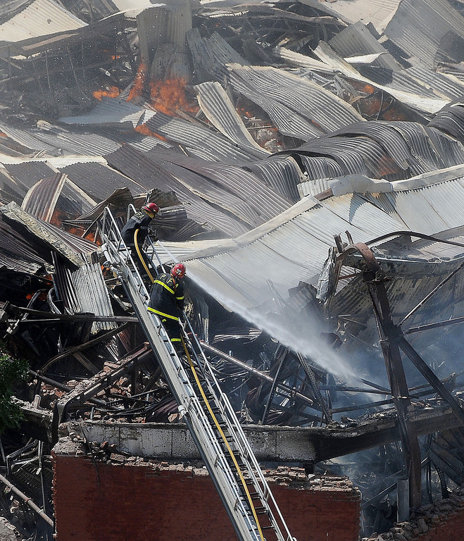 . Picture released by Diario Popular via Noticias Argentinas showing firemen fighting a fire at a warehouse in Barracas, in southern Buenos Aires, on February 5, 2014.  AFP PHOTO / NA / DIARIO POPULAR / GUSTAVO FIDANZA   /AFP/Getty Images