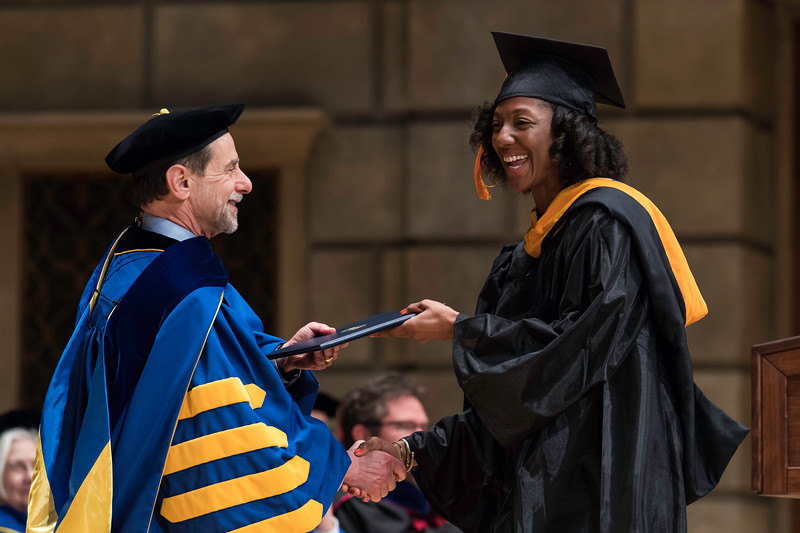 Alexandria Kelley receives her diploma from UR president Rich Feldman. // University of Rochester School of Nursing Commencement, Kodak Hall at Eastman Theatre May 17, 2019.  // photo by J. Adam Fenster / University of Rochester