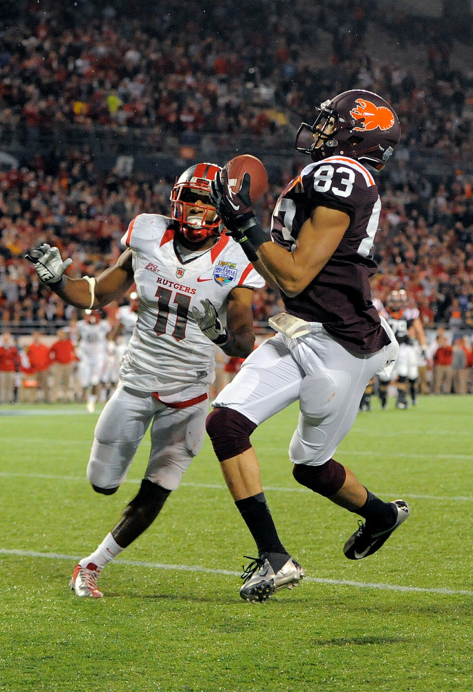 . Virginia Tech wide receiver Corey Fuller, right, hauls in a pass in the end zone for a touchdown in front of Rutgers defensive back Logan Ryan, left, during the fourth quarter of an NCAA college football Russell Athletic Bowl game on Friday, Dec. 28, 2012, in Orlando, Fla. (AP Photo/Brian Blanco)